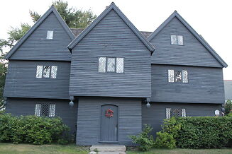 photo shows the facade of the deep black salem witch house