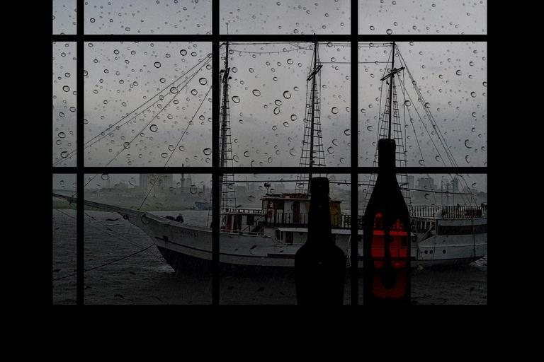 photo shows an old fashioned ship through a window covered with raindrops