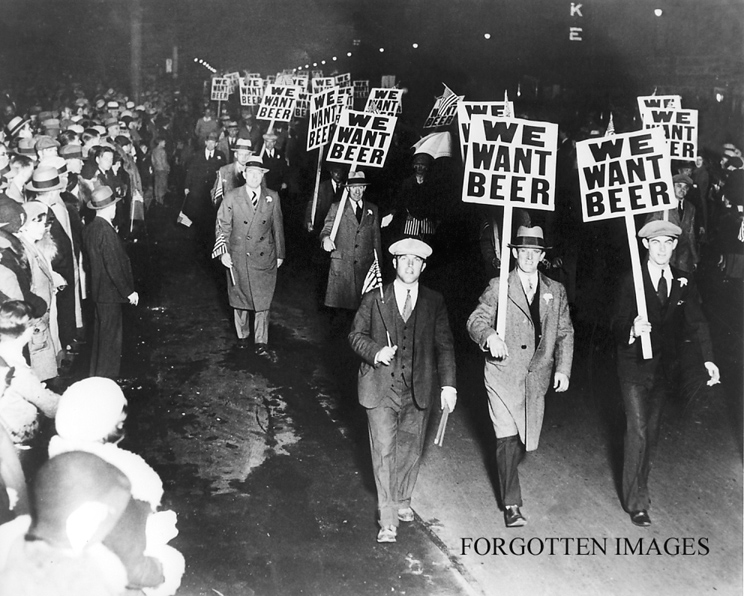 photo shows a group of protesting men in suits with signs that read 'we want beer'
