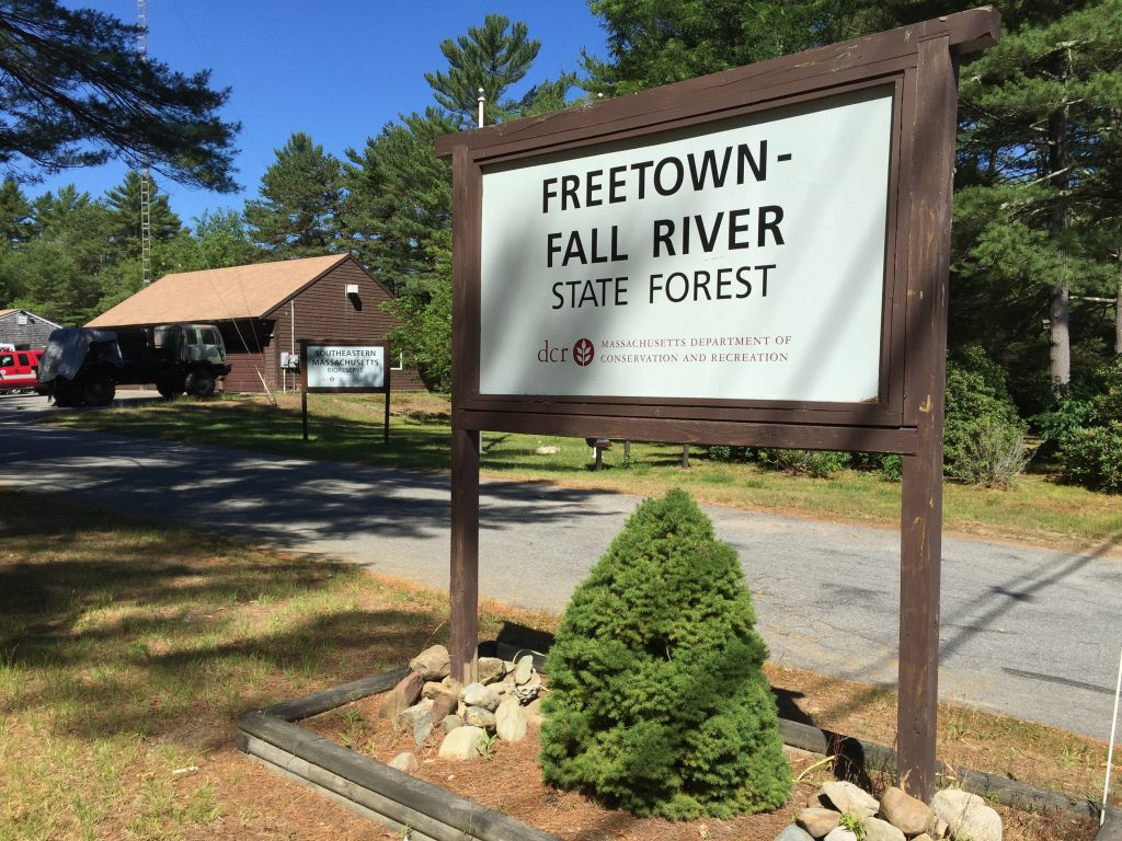 photo shows the freetown fall river forest entrance sign