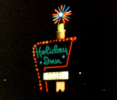 photo shows a vintage holiday inn neon sign