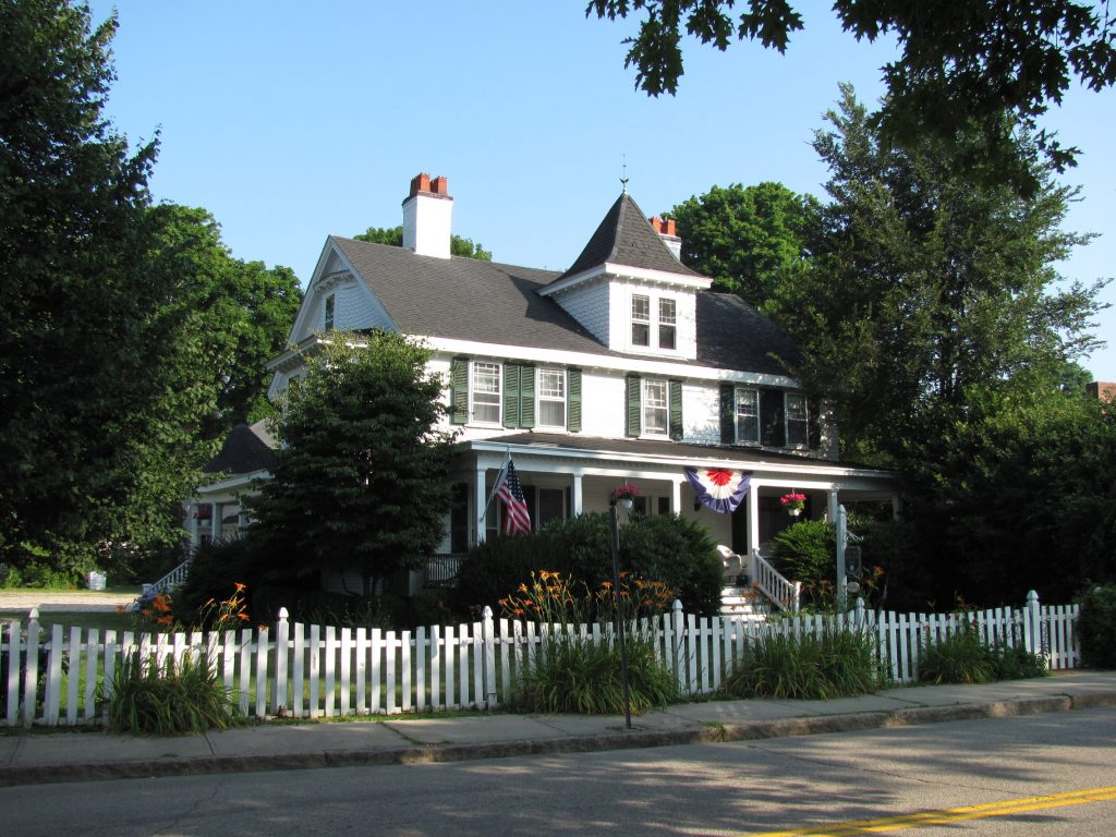 photo shows the front of the Village Green Inn, a victorian style mansion.