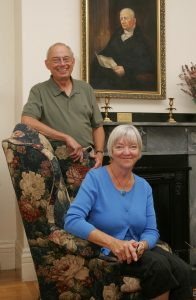 photo shows dick and diane pabich sitting in the front room of the salem inn