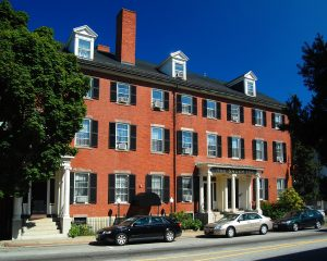 photo shows the front of the west house, the main portion of the salem inn. the home is made of red brick and has over 20 windows in the front!